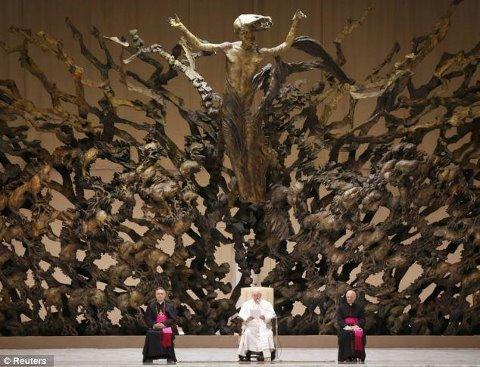 pope and strange reptilian like scene